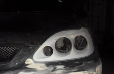 Headlamp housing under modular optics