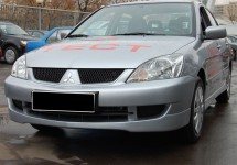 The front bumper spoiler for Mitsubishi Lancer IX